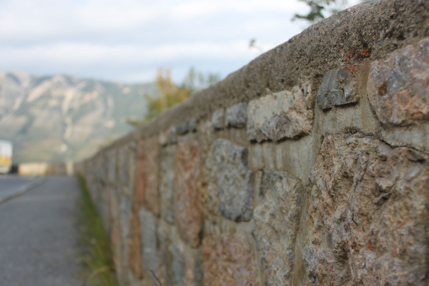 Close up of completed stone highway barrier